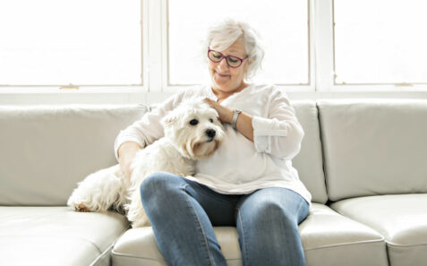 Pet therapy for seniors with elderly woman and dog.