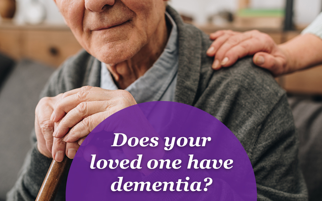 """Cropped photo of an elderly man with a cane with a comforting hand on his shoulder. Text overlay reads, """"Does your loved one have dementia?"""""""